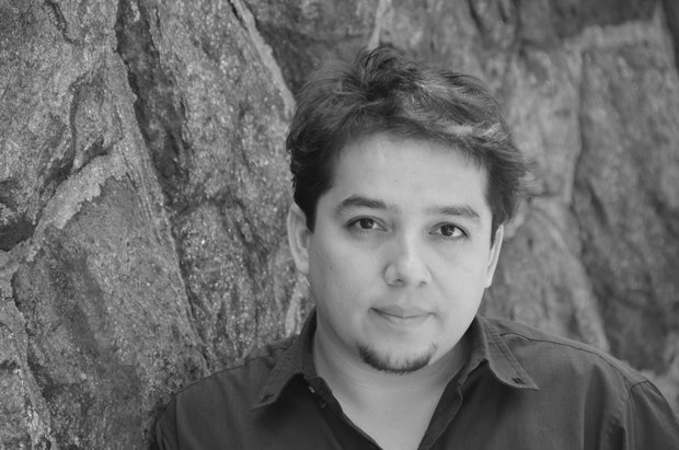 Black and white headshot of Matthew Paul Olmos