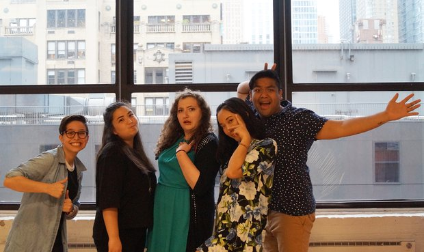 From left to right: Anna Brenner gives two thumbs up, Sarah Haber puffs out her cheeks, Chloe Knight looks incredulous, Mona Moriya does a peace sign over her eye, and Chris Reyes swings his hand out to the side.