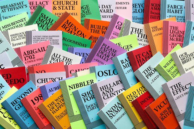 "A colorful pile of acting editions of plays, all published by Dramatists Play Service. Visible title include ""Nibbler"", ""The Effect"" ""Men on Boats"" ""Small Mouth Sounds"" and ""Hillary and Clinton"""