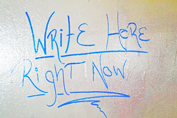 """Write Here Right Now"" written on wipeboard"