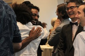 Jerron Herman and Nikomeh Anderson hug  Lloyd Suh and Gregg Mozgala smile..