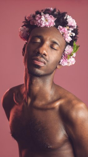 Donja R. Love with a pink flower crown in his hair.