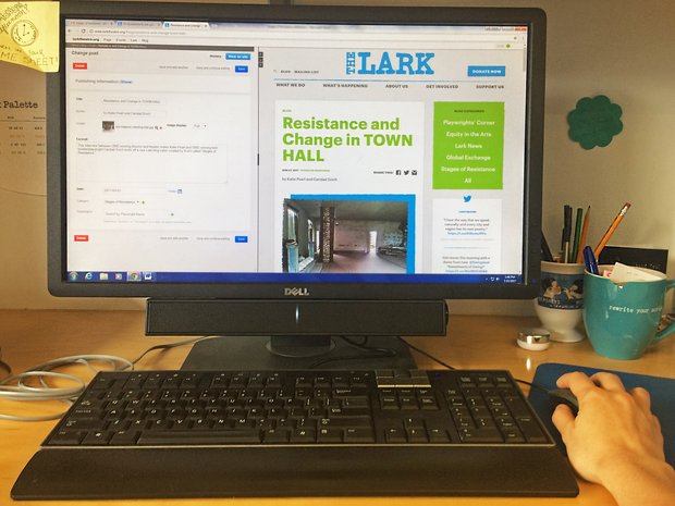 "A computer screen displays the back end of The Lark's website as an article called ""Resistance and Change in TOWN HALL"" is edited."