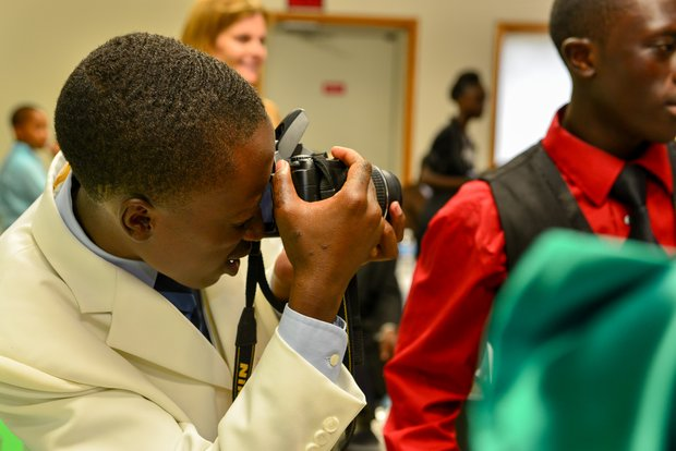 Tierre Kagoma, originally from Burundi, taking a photography class taught by Lark Board Member Lori Steinberg.
