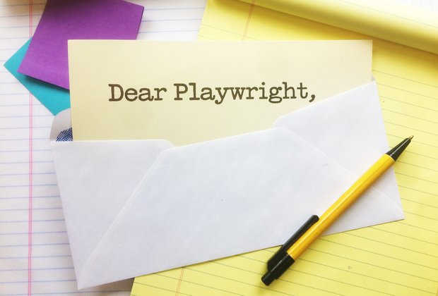 "A piece of paper sticks out of an envelope. It reads, ""Dear Playwright,"""